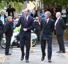 William looked sharp in a dark blue suit and a navy and red striped as he arrived for a day of engagements focusing on post-military employment