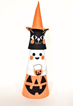 Make Halloween Felt Cone Friends. These make the cutest Halloween decorations or toys for kids to play with. They can be stacked or played with separately!