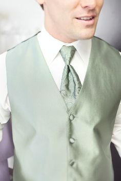 Sage green tux vest with paisley tie (possible for Robin with maybe the tux in a dark grey or sterling silver)
