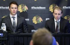 Chicago Blackhawks' Patrick Kane, right, speaks as Jonathan Toews listens during a news conference at the United Center in Chicago, Wednesday, July 16, 2014. The Blackhawks recently agreed to eight-year contract extensions with Toews and Kane. (AP Photo/Nam Y. Huh)