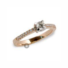 Ένα μοντέρνο μονόπετρο δαχτυλίδι από ροζ χρυσό  amp  λευκόχρυσο Κ18 με  κεντρικό Brilliant στη λευκόχρυση 5d1375bf717