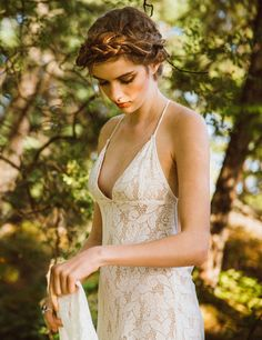This effortlessly beautiful lace wedding dress was created for the free spirited bride who wants to have a light wedding dress that is absolutely captivating. It was designed to be form fitting and sexy, while maintaining a sculpted shape that starts at the plunging neckline and sweeps across to the small of the back. This dress is perfect for a destination wedding, not only because it was designed with the beach in mind, but also because it weighs next to nothing! This seductive go...