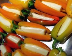 """Low carb snacks to go """"Yummy! Take mini peppers, make a slit in it and put half a string cheese in it ... Easy go to snack!"""""""