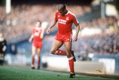 Liverpool's John Barnes backheels off the pitch a banana thrown from the crowd during a Merseyside derby at Goodison Park in John Barnes, Liverpool Football Club, Liverpool Fc, Manchester City, Merseyside Derby, Rio Ferdinand, Football Pitch, Football Team, Soccer