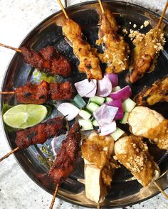 Hooray for Satay! Love @lautnyc scrumptious platter of grilled meats on a stick! Wash it down with refreshing @bira91beer and have yourself a Southeast Asian feast!  #BeBira #lautnyc #beer #indianbeer #indiancraftbeer #SoutheastAsianFood #malaysianfood #singaporeanfood #nyceats #jeaniuseats