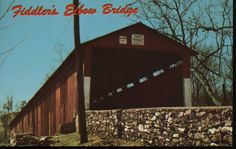 Fiddler's Elbow Bridge Postcard – LC-152 Color photo postcard picturing Fiddler's Elbow Bridge. This covered bridge, built southwest of Hummelstown, PA was lost in the flood of 1972. The descriptive name came from the contour of the Swatara Creek. The picture was taken a few weeks before hurricane Agnes destroyed the bridge.