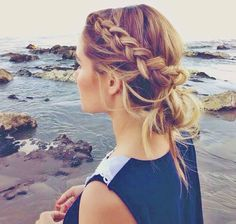 Side braid and messy bun. Cute summer beach hair