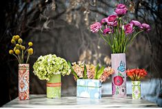 Step by step tut on tin can vases using pretty paper and ribbon to cover. Great for center pieces
