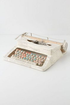 Originally trained in textiles, artist and designer Jennifer Collier now works with paper - bonding, waxing, trapping and stitching to create unique sculptures from otherwise forgotten documents. Here, she repurposed vintage papers into a lifelike replica of a typewriter #anthropologie