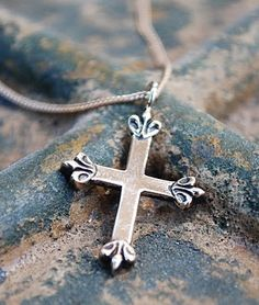 """A very unique cross with fleur de lis on each end. """"Believe"""" is stamped on the back. Powerful and beautiful."""