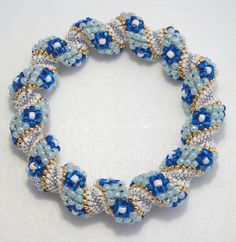 Cellini Spiral Bracelet with Blue Flowers by DynamicBeadz on Etsy