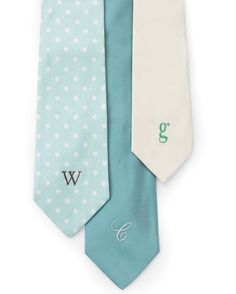 Here's another take on a personalized tie for Dad: Print his initial in a large-size font, then make a stencil of it using a craft knife before embroidering.