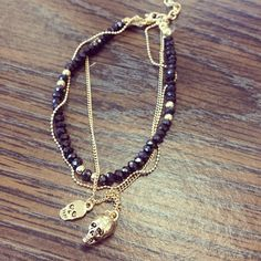 """Beaded gold bracelet with blue or black beads with a gold skull charm. Adjustable from 7"""" to 9"""""""