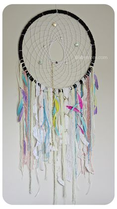 Create a unique DIY hula hoop dreamcatcher. This decorative dreamcatcher can be made for your home or as a gift, personalized with colours to match any room
