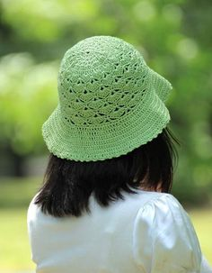 Green crocheted summer hat with