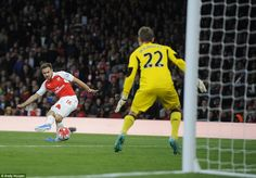 Aaron Ramsey fires the ball past Simon Mignolet but his effort was deemed to be offside by...