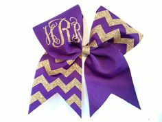 The base of the bow is 3 purple, grosgrain ribbon and the overlay on one half is chevron gold glitter heat transfer vinyl. The monogram is in