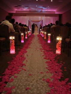 flowers and candles down the aisle... cute for an evening wedding Not so sure about the pink, but I like the idea.