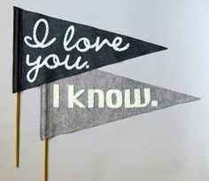 """Could these """"I love you"""" pennant flags be any more appropriate for a Star Wars wedding? Use them in the photo booth or ask guests to wave them when you walk down the aisle."""