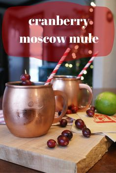 cranberry moscow mule recipe made with cranberry simple syrup. an easy, festive twist on the classic moscow mule. it's perfect for any holiday parties you might have this season! || everything with love