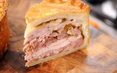 Chicken and Ham Hock Pie Recipe by Andy Bates. Sounds like my Mom's old english recipe. Served cold. Has a round hole in the middle.