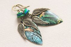 Blue Green Wing Earrings Antique Brass Wing Charms on Vintage Tin by MusingTreeStudios, $18.99 #etsy #handmade #jewelry