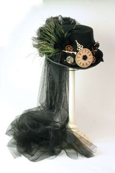 Black Tulle Steam Punk Hat Watchmaker elements marry together within plumage and lace to remind us of time's passage. Arrives in a keepsake hatbox. Steampunk Couture, Moda Steampunk, Viktorianischer Steampunk, Costume Steampunk, Steampunk Design, Steampunk Wedding, Steampunk Clothing, Steampunk Fashion, Steampunk Crafts