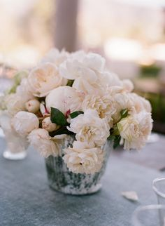 Mindy Rice designed the elegant fresh-from-the-garden centerpieces.    Photos byLittle White Dress  Coordination byLisa Vorce of Oh How Charming!  Flowers byMindy Rice Floral Design
