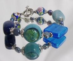 An unusual handcrafted bracelet design crafted from a collection of blue beads