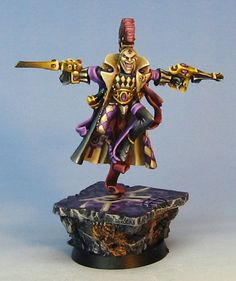 Eldar Harlequin James Wappel has been painting miniatures professionally for many years. He has a very bright and vivid style, lots of highlights, including non-metallic metals. The miniature itself is made by Games Workshop.