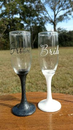 Items similar to Glitter Bride and Groom toasting flutes set ~ Champagne Flutes ~ Wedding glasses on Etsy Bride And Groom Glasses, Wedding Wine Glasses, Diy Wine Glasses, Wedding Champagne Flutes, Champagne Glasses, Personalized Champagne Flutes, Personalized Wine Glasses, Wedding Colors, Wedding Decor