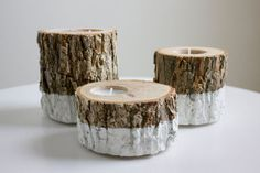 Drill out holes in logs for candles on tables?