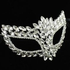 """A full bejeweled mask is all the rage at any masquerade party. Held by black satin ribbons at approximately 44"""" wide and 6"""" in height."""