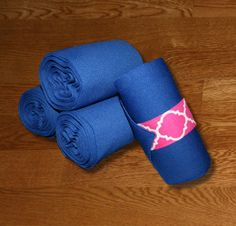 """Equine Standing Wraps/Royal Standing Wraps w/Fuchsia Quatrefoil Velcro by KLMequestrian.com These stylish standing wraps are made of royal stretch polyester. The material is comparable to the stable bandages from Dover Saddlery. Made with industrial strength velcro to ensure a strong hold. Sold in Set of 4 Wraps. Two sizes offered: Pony: 2 yards (6ft) long, 5"""" wide or Horse: 4 Yards (12 ft) long, 5"""" wide."""
