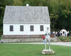 Photo of Tesla Birth House and Memorial Statue for fans of Nikola Tesla. House where Tesla was born and a memorial statue of him in Smiljan, Croatia.