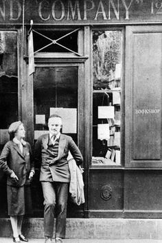 Photographic Print: Sylvia Beach and Ernest Hemingway in Front of Shakespeare and Company Bookshop, C.1928 : 24x16in