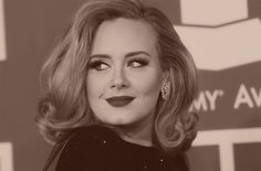Adele looks gorgeous here...love the hair & makeup!  She is stunning!