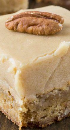 Butterscotch Blondies ~ Insanely buttery Butterscotch Blondies loaded with toasted pecans and topped with a thick layer of Brown Sugar Frosting. These blondies are sinful! So sweet and buttery. They are beyond indulgent