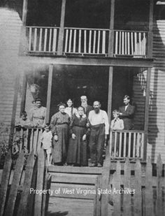 Hatfield Family on porch-    Hatfield Family on porch-includes Ossie Browning (granddaughter), Uncle Dyke Garrett (back), and Rossie Browning (left).