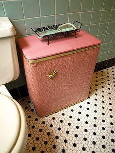 I love this coral pink tone and gold embellishment. I found a brown vintage laundry hamper and am in the process of up-cycling it with white, turquoise and coral.