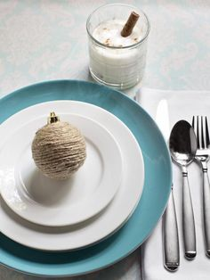 Beige as an accent color? Yep! While turquoise is often paired with jewel tones and metallics in holiday decor, pairing the jewel tone with a muted, neutral tone — such as parchment — is much less expected. This is an excellent way for colorphobes to introduce more saturated hues into their holiday decor without being overwhelmed.