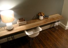 reclaimed wood console with awesome metal legs.