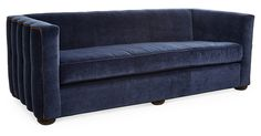 The tuxedo silhouette, blue velvet upholstery, and channeled exterior sides and back of this sofa speak to its Art Deco influences and ensure that it looks glamorous from every angle, making it...