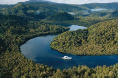 Gordon River Cruise, Tasmania, Australia. This ancient, breathtaking river winds its way through temperate rainforest and mountains into Macquarie Harbour and finally to the open ocean through the turbulent Hell's Gates. Enjoy comfort and beauty on this cruise.