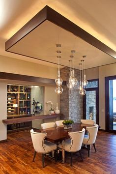 Modern Dining Room With False Ceiling Designs And Suspended Lamps