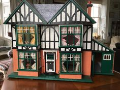 Dolls house - Vintage 1930's Tudor dolls house, plus box of furniture, etc.