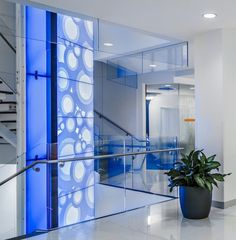 Custom tower structures of curved aluminum and custom blue polymer with integrated lighting and media. Jet Blue Corporate office, designed by HLW Architects