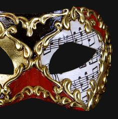 The traditional signs of the Carnival of Venice (red, black, gold and music paper) meeting for a touch of sophisticated elegance.