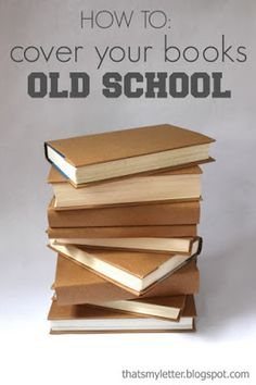 stacked books covered in brown kraft paper as a centerpiece or cake stand