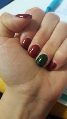 Gel nail art. Christmas nail art, holidays, red and green sparkles, accent nail.